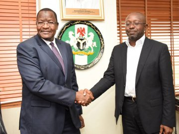 Prof. Danbatta in a warm handshake with Mr. Boye Olusanya, Chief Executive Officer 9mobile (formerly ETISALAT)